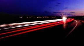 高速公路日落线索 免版税库存照片