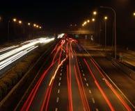 高速公路晚上业务量 图库摄影