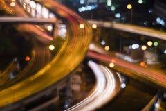 高速公路的被弄脏的bokeh图象在夜间的 库存图片