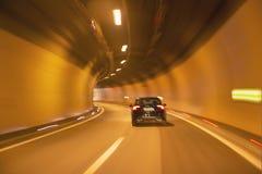 高速抽象驾驶在隧道 免版税库存照片
