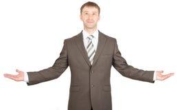 兴高采烈的商人伸了他的手 免版税库存图片