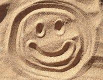 兴高采烈的沙子面孔 图库摄影