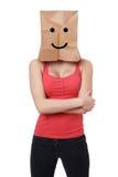兴高采烈的纸袋妇女 免版税库存图片