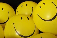 兴高采烈的面孔气球 免版税库存照片
