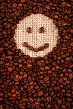 兴高采烈的面孔由咖啡制成 免版税库存图片