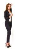 高雅妇女站立与空白的横幅。 免版税库存照片