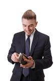 高兴成功的微笑的bussinessman得到这样他的工作的很多金钱 免版税库存图片