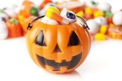 鬼的橙色万圣夜糖果 免版税库存图片