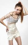魅力礼服的美丽的时兴的女孩 库存照片