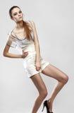魅力礼服的美丽的时兴的女孩 免版税库存照片