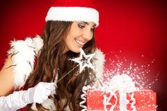魔术圣诞老人鞭子妇女 库存照片