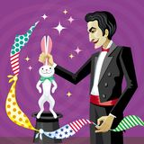 魔术师从帽子里面拉兔子 库存图片