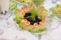 鱼和鸡蛋用鱼子酱 免版税库存图片