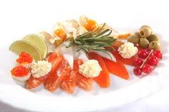 鱼盛肉盘用柠檬 免版税库存图片