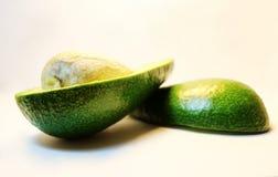 鲕梨 鲕梨果子  切片鲕梨 鲕梨的骨头 图库摄影