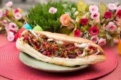 鲜美五颜六色的三明治用法国小圆面包 免版税库存照片