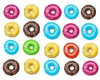 鲜美五颜六色的油炸圈饼背景 免版税库存照片