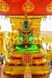 鲜绿色菩萨雕象Wat Phrathat土井素贴 库存照片