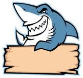 鲨鱼举行木头标志 库存图片