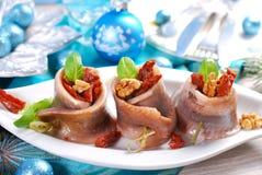 鲱鱼开胃菜滚动用干蕃茄和核桃chr的 库存照片