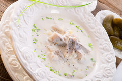 鲱鱼用土豆和奶油 免版税库存照片