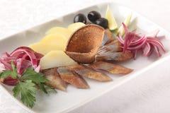 鲱鱼用土豆和葱 库存照片