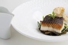 黑鳕鱼用猪肉调味汁 库存照片