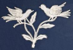 鸟刺绣 免版税库存图片