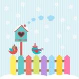 鸟和鸟舍冬天 免版税库存照片
