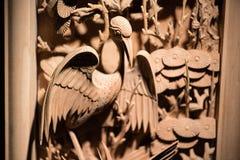 鸟繁体中文木雕  图库摄影