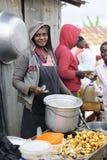 鸡卖主在海地的市场上 图库摄影