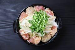 鸡和蘑菇火锅粮食  免版税库存照片