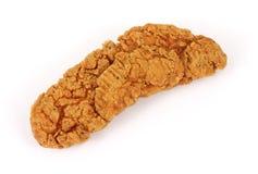 鸡嘎吱咬嚼的油煎的部分 免版税图库摄影