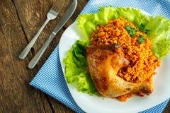 鸡大腿鲜美盘用米 免版税库存图片
