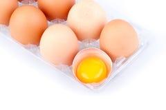 鸡蛋和卵黄质在塑料透明包裹 库存照片