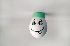 鸡蛋快乐与在头的面孔立场 免版税图库摄影