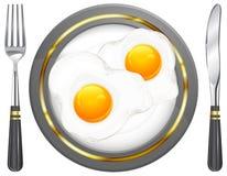 鸡蛋油煎的牌照 免版税库存图片
