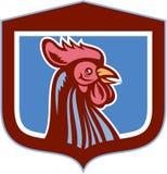 鸡雄鸡头减速火箭侧视图的盾 免版税图库摄影