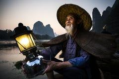 鸬鹚渔夫画象 免版税库存照片