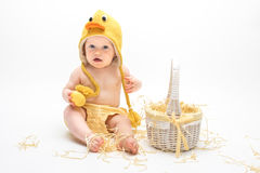 鸭子服装的复活节婴孩 图库摄影
