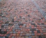 鹅卵石水平的老路面 免版税库存图片