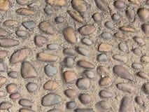 鹅卵石路详细的看法为作为背景或墙纸的使用 免版税库存图片
