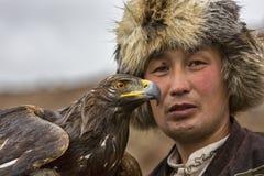 鹫和猎人 免版税库存照片