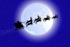 鹿他的圣诞老人雪撬 免版税库存图片
