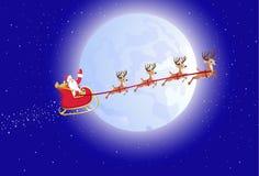 鹿他的圣诞老人雪撬 免版税库存照片