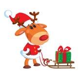 鹿和雪撬有箱子的 库存照片