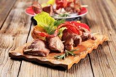 鹿肉souvlaki和咸肉条 免版税库存图片