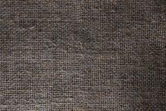 麻袋布黑暗背景 免版税库存图片