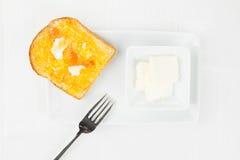 黄油叉子法国橘子果酱橙色多士 免版税库存照片