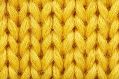 黄色作为背景的被编织的织品纹理, 库存照片